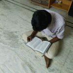 indian man reading bible