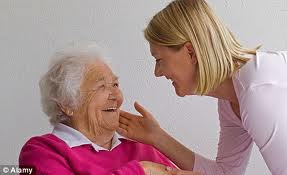 young lady being kind to old lady