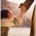 20-woman taking jesus hand
